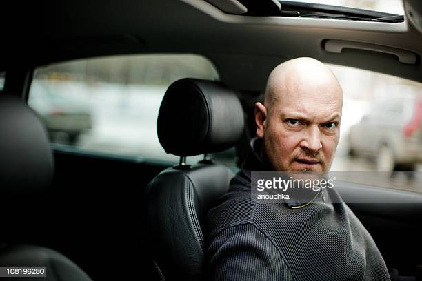 Man Sitting in Car with Black Leather Interior