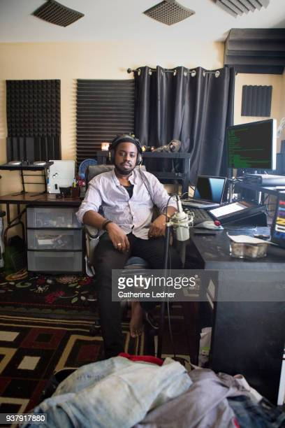 Man sitting in chair in home sound studio
