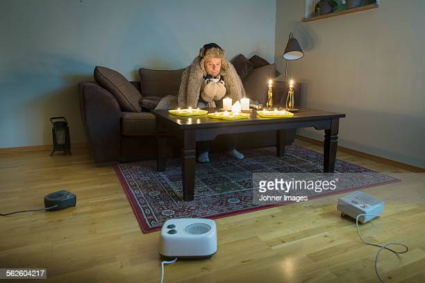 Man sitting in cold living room