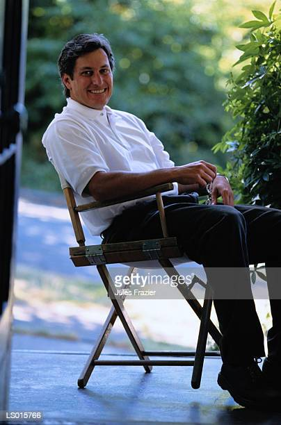 Man Sitting in Director's Chair