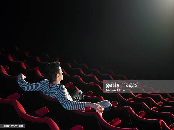 man sitting in empty cinema - one man only stock pictures, royalty-free photos & images