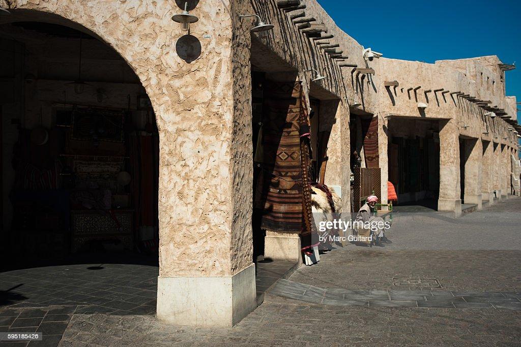 Man Sitting In Front Of A Shop In Souq Waqif Souq Waqif Is A