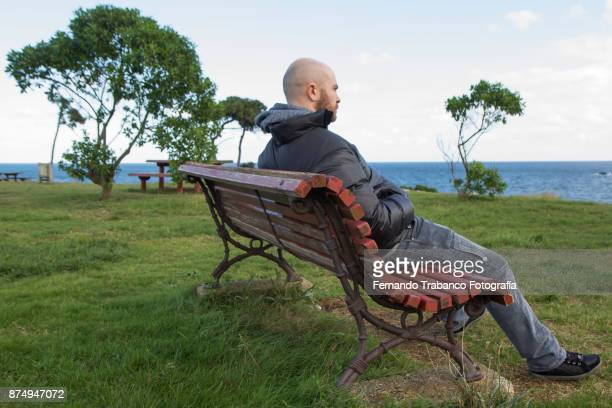 man sitting in front of the sea