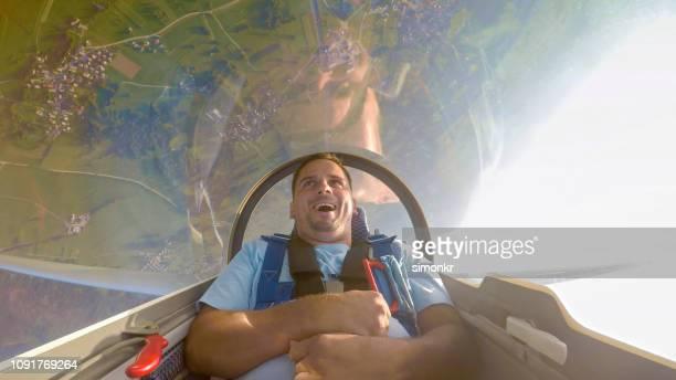 Man sitting in glider airplane