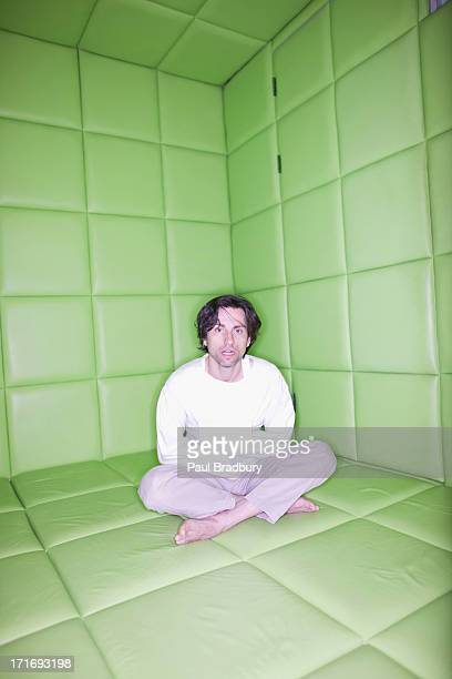 man sitting in padded room - straight jacket stock pictures, royalty-free photos & images