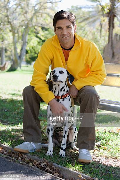 Man sitting in park with his dog