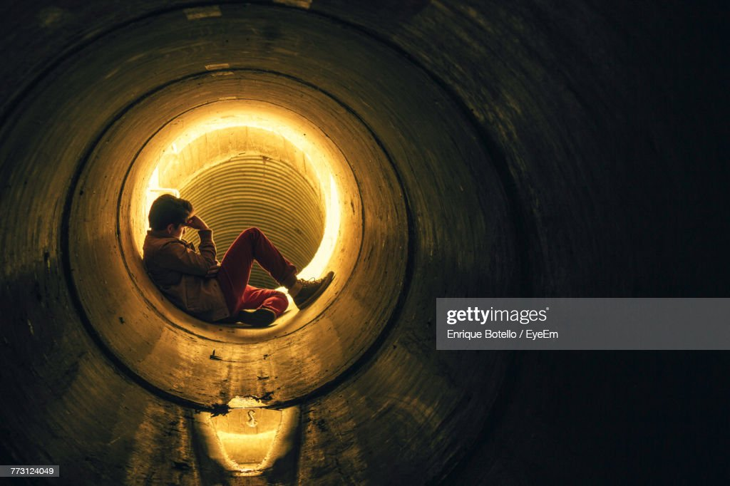 Man Sitting In Pipe : Photo