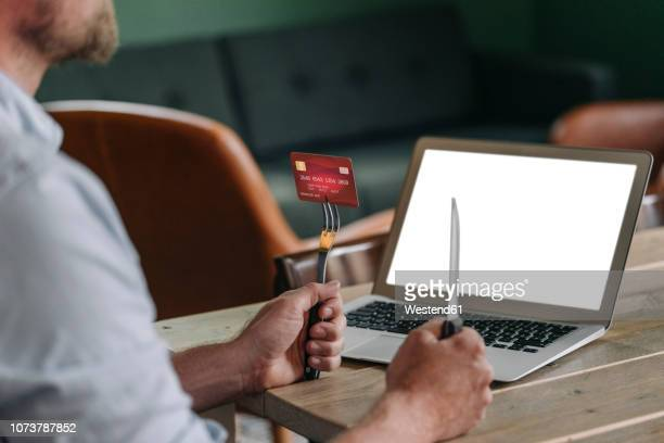 man sitting in restaurant, waiting for delivery service - social grace stock pictures, royalty-free photos & images