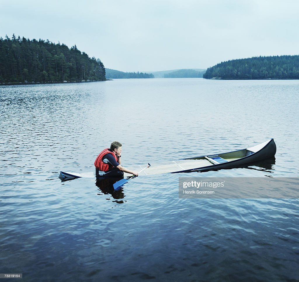 man sitting in sinking kayak side view stock photo getty images