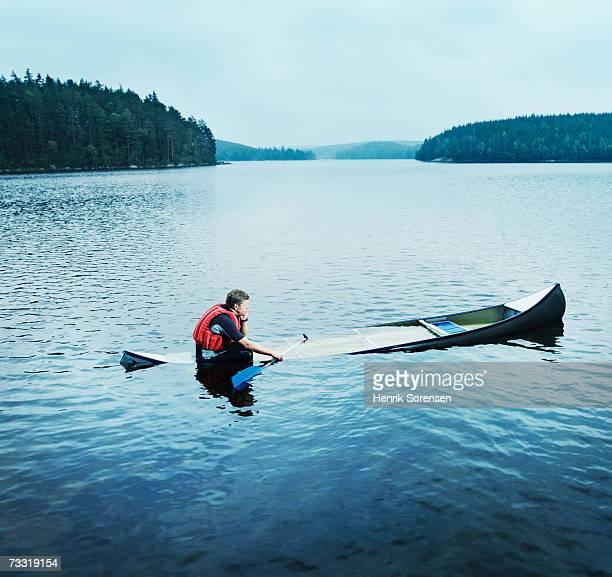 man sitting in sinking kayak, side view - sinking stock pictures, royalty-free photos & images