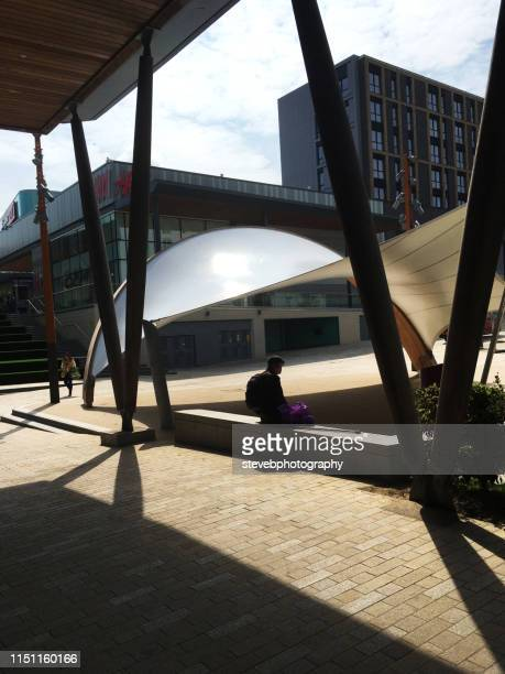man sitting in the shade - stevebphotography stock pictures, royalty-free photos & images