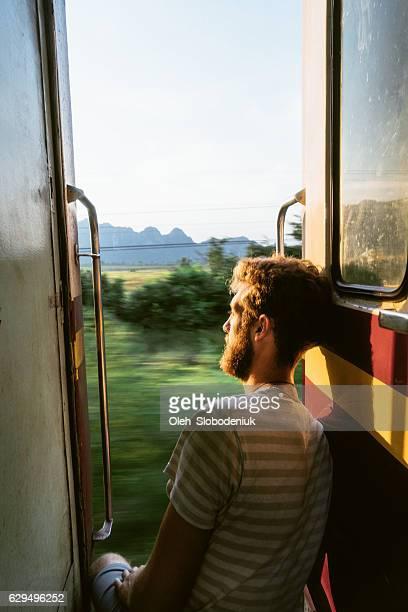 Man sitting in the train doors