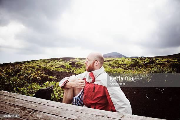 Man sitting in the wilderness