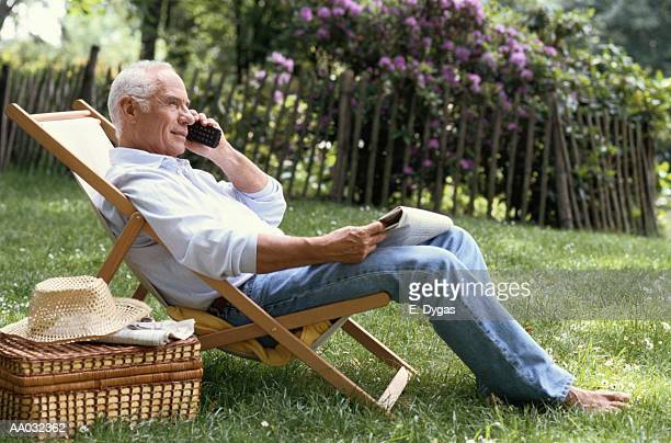 Man Sitting in the Yard on the Phone