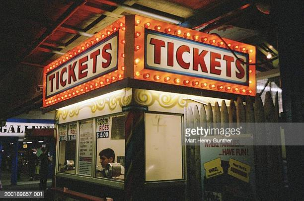 Man sitting in ticket booth