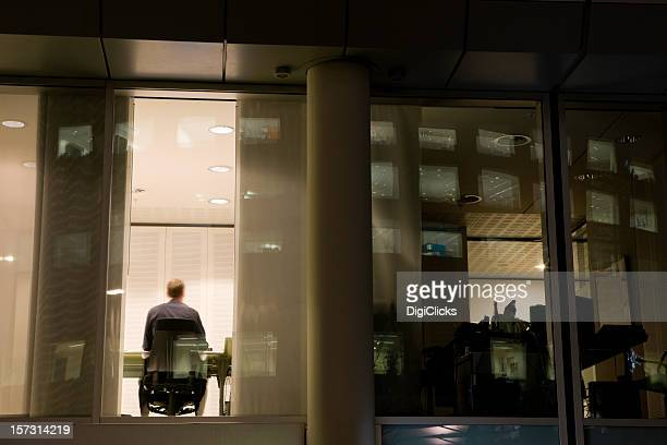 Man sitting inside working late at night