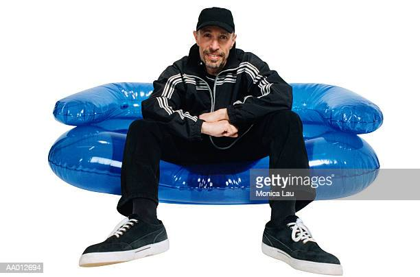 Man Sitting on an Inflatable Chair
