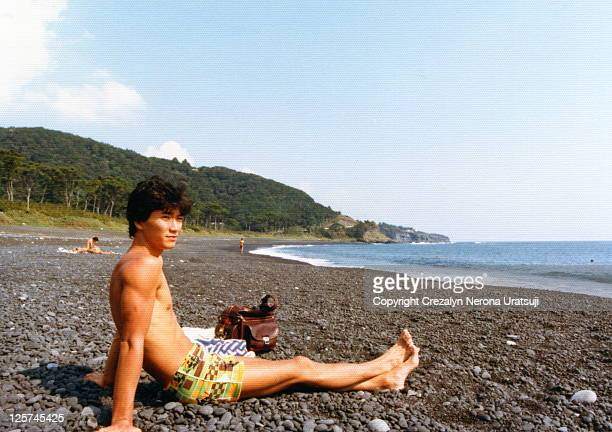 man sitting on beach relaxing - showa period stock pictures, royalty-free photos & images
