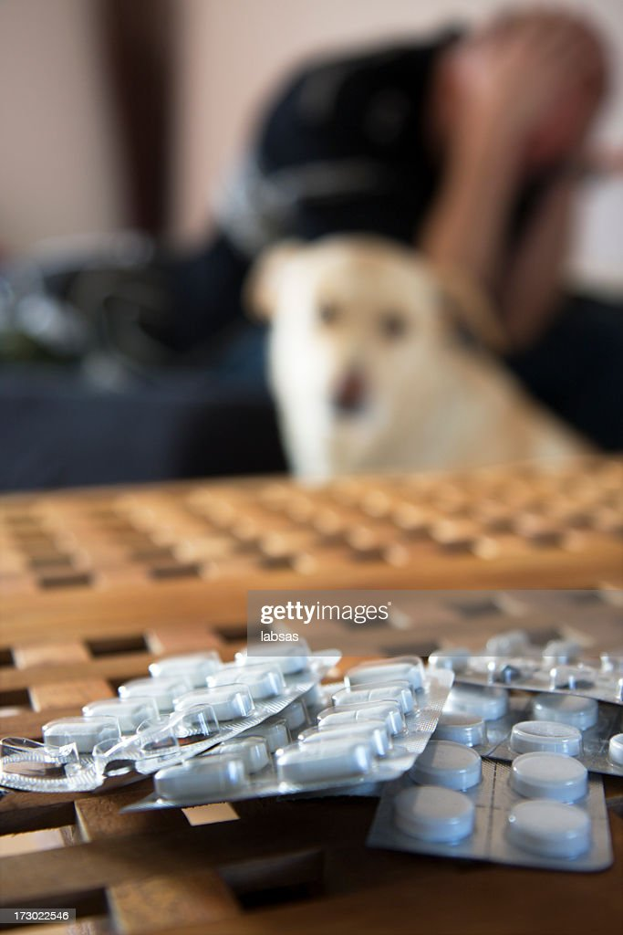 Man sitting on bed. Pills in focus. Shallow dof. : Stock Photo