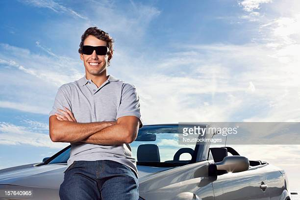 Man Sitting on Car