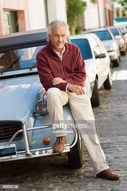 Man sitting on car