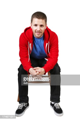 Man Sitting On Chair Leaning Forward Stock Photo Getty