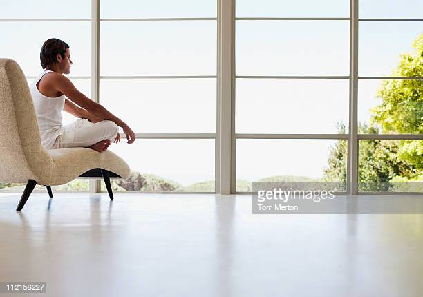 Man sitting on chaise longue in living room