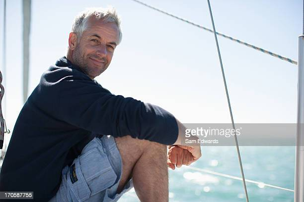 Man sitting on deck of boat