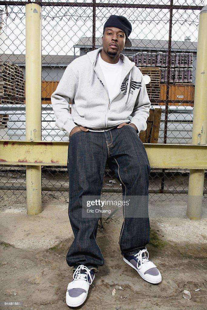 Man sitting on fence : Stock Photo