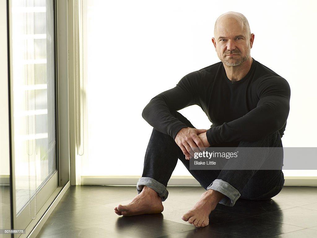 Man sitting on Floor : Stock Photo