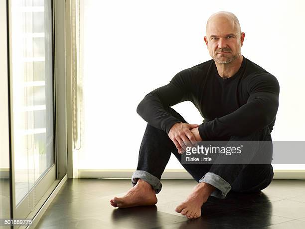 man sitting on floor - goatee stock pictures, royalty-free photos & images