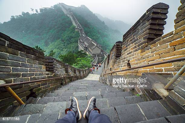 Man Sitting On Great Wall Of China