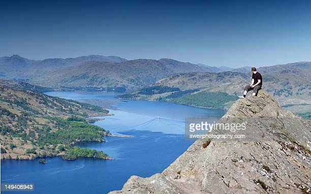 Man sitting on hill top