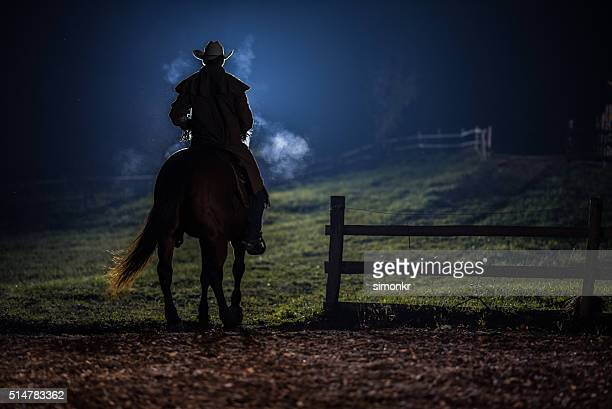 man sitting on horse - cowboy stock pictures, royalty-free photos & images