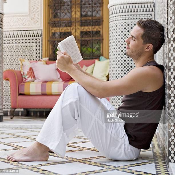 man sitting on mosaic floor - hugh sitton stock-fotos und bilder