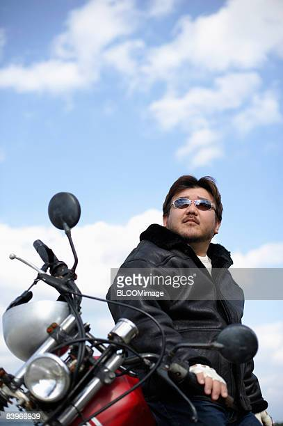Man sitting on motorcycle