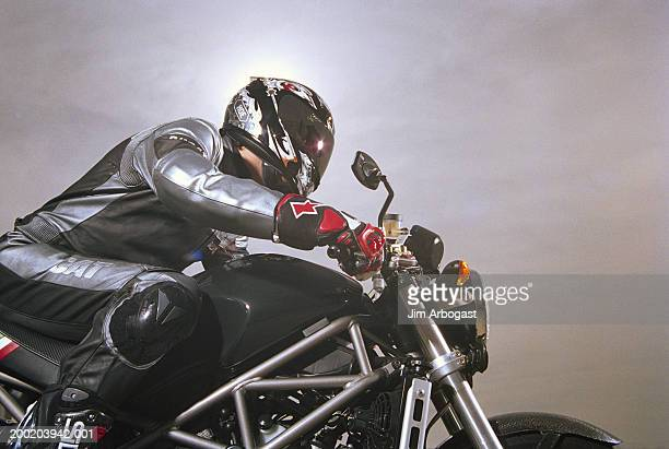 Man sitting on motorcycle, side view
