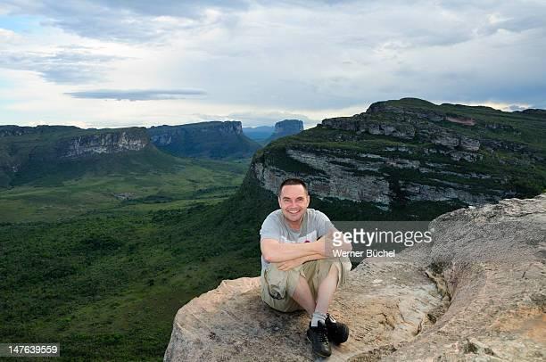 Man sitting on mountain in Chapada Diamantina