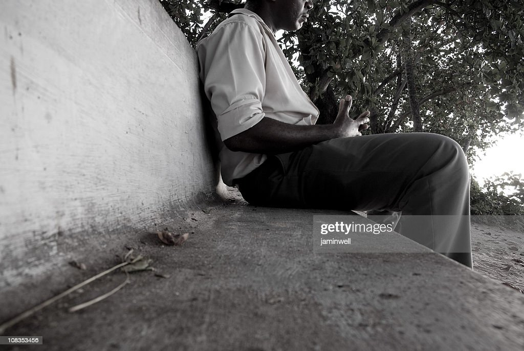 man sitting on outdoor park bench : Stock Photo