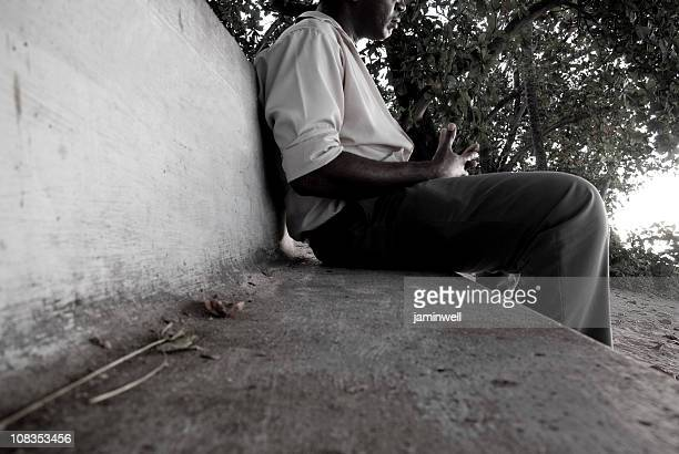 man sitting on outdoor park bench