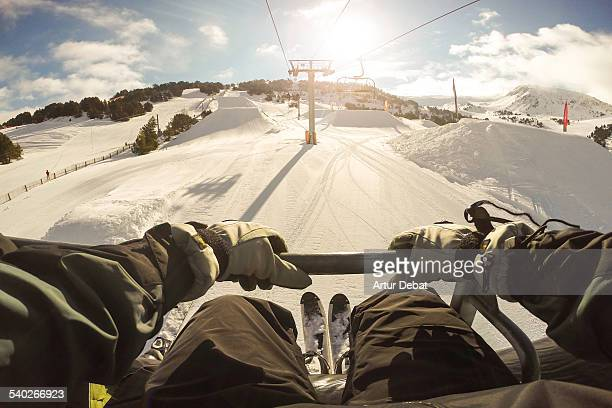 man sitting on ski lift in the pyrenees from pov. - ski lift stock pictures, royalty-free photos & images