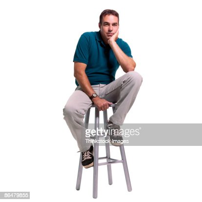 Man Sitting On Stool Stock Photo Getty Images