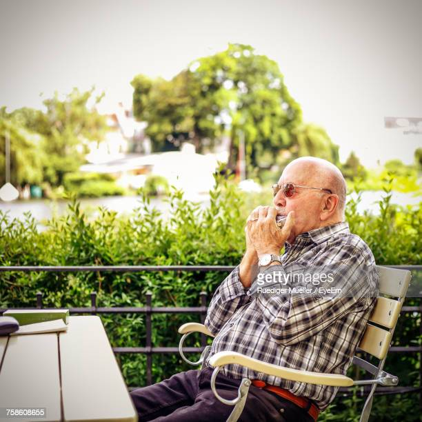 Man Sitting On Table By Chair