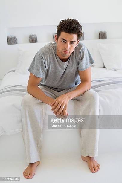 man sitting on the bed - tracksuit bottoms stock pictures, royalty-free photos & images