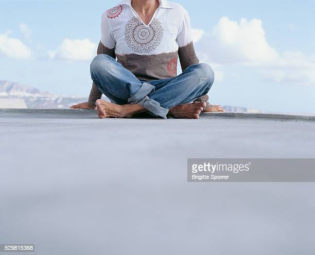 Man Sitting on the Ground Outdoors
