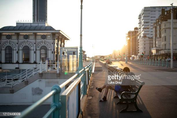Man sitting on the promenade works on his laptop on May 9, 2020 in Brighton, England. On Sunday February 2nd 2020 businessman Steve Walsh reported...