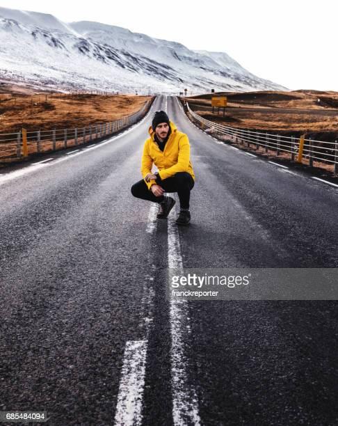 man sitting on the raod in iceland