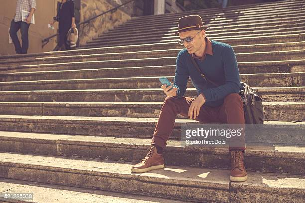 man sitting on the steps