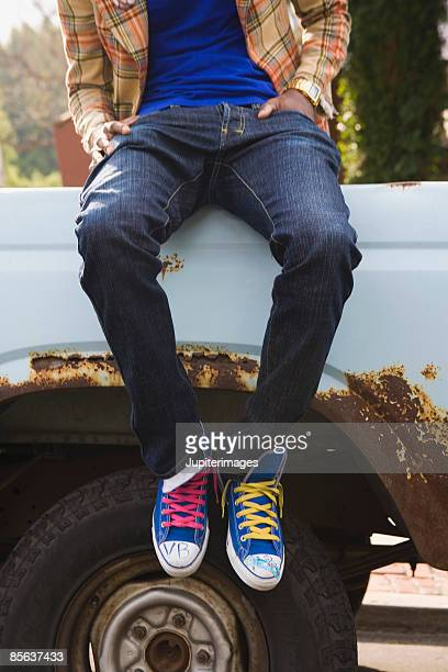 Man sitting on truck bed