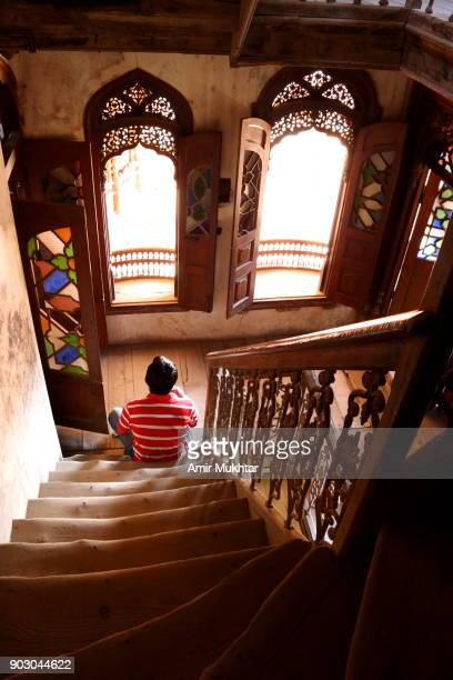 Man Sitting On Wooden Stairs